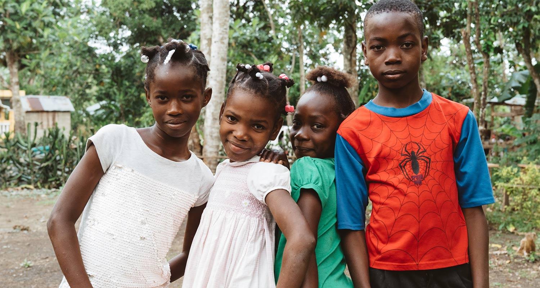 Children near a Care 2 Communities clinic