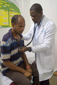 Dr. Richard with a patient