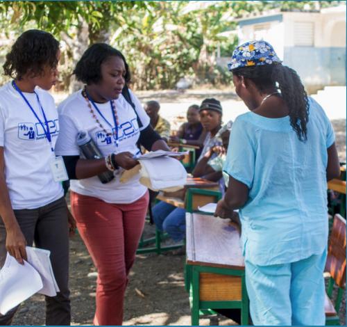 Educators at a Haiti clinic doing patient education